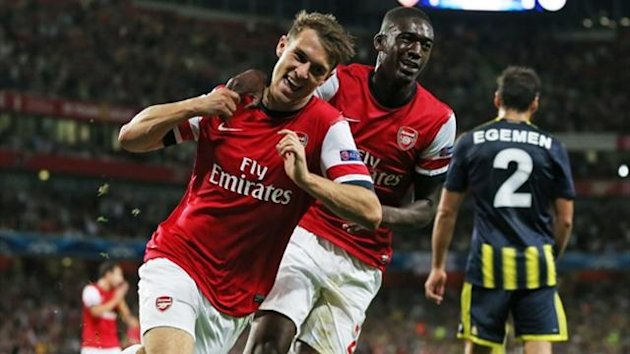 Arsenal midfielder Aaron Ramsey (L) celebrates with Yaya Sanogo after scoring his second goal against Fenerbahce (AFP)