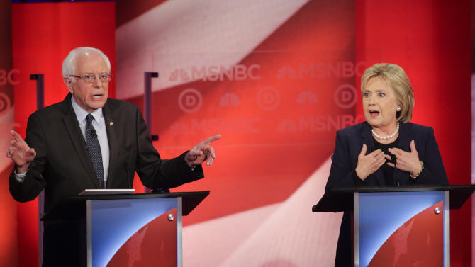 Democratic presidential candidate, Sen. Bernie Sanders, I-Vt, and Democratic presidential candidate, former Secretary of State Hillary Clinton spar during a Democratic presidential primary debate hosted by MSNBC at the University of New Hampshire Thursday, Feb. 4, 2016, in Durham, N.H. (AP Photo/David Goldman)