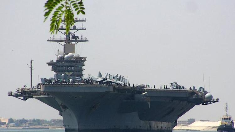 Satellite imagery shows a vessel resembling an American Nimitz-class aircraft carrier -- like this USS Dwight D. Eisenhower seen near Cairo, Egypt, on June 13, 2013 -- being constructed near Bandar Abbas