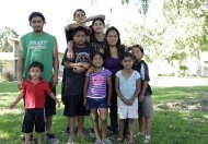 This photo taken Saturday June 1, 2013, in Fresno, Calif. shows farmworker Cristina Melendez posing with her seven children and one grandchild. A Mexico native who came to the U.S. at age 13, Melendez and the children have for years struggled with poverty in the San Joaquin Valley, one of the richest agricultural regions in the world. (AP Photo/Gosia Wozniacka)