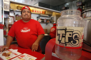 Mauricio Garcia, manager of Scooby's Hot Dog restaurant…