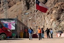 """<p> In this May 23, 2013 photo, security officers walk away from the entrance of the Barrick Gold Corp's Pascua-Lama facilities, in northern Chile. Chile's environmental regulator blocked Barrick Gold Corp.'s $8.5 billion Pascua-Lama project on Friday, May 24, 2013, and imposed its maximum fine on the world's largest gold miner, citing """"very serious"""" violations of its environmental permit as well as a failure by the company to accurately describe what it had done wrong. (AP Photo/Jorge Saenz)"""