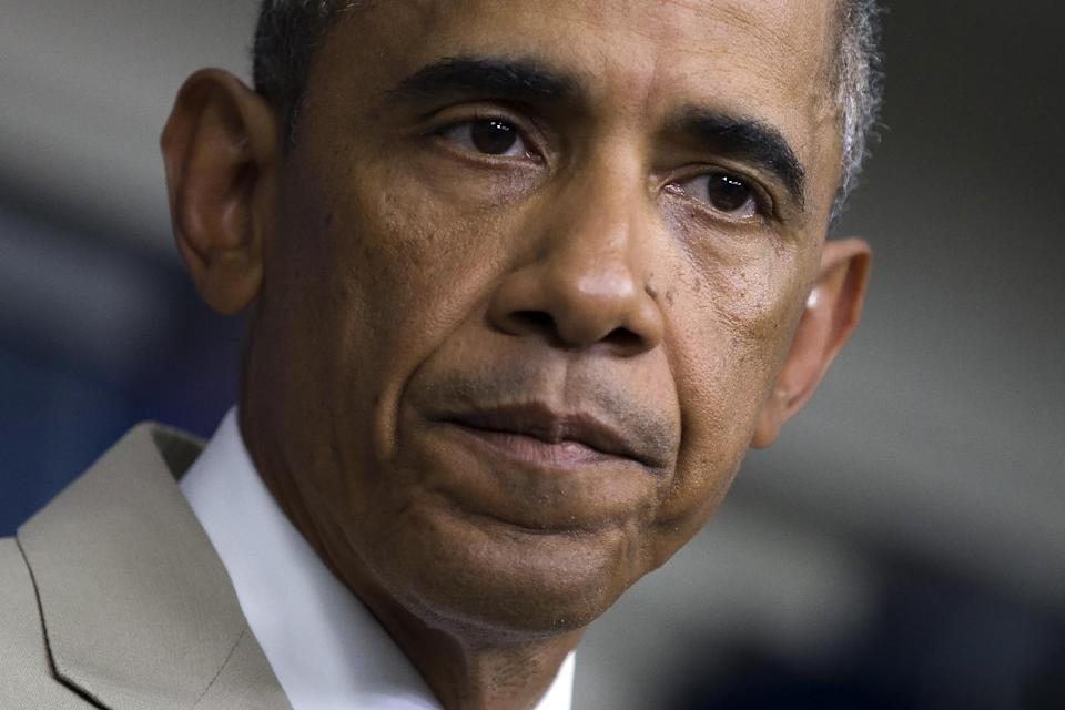 President Barack Obama listens in the James Brady Press Briefing Room of the White House in Washington, Thursday, Aug. 28, 2014, where he spoke about ...