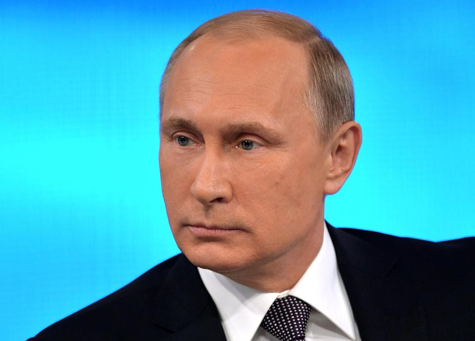 Russian President Vladimir Putin listens for a question during a nationally televised question-and-answer session in Moscow, Thursday, April 16, 2015....