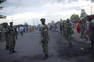 Soldiers stand on the main road in the Cibitoke neighbourhood…
