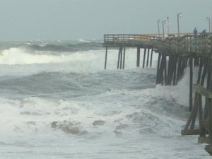 Pier in Kitty Hawk, NC taking huge hurricane like waves …