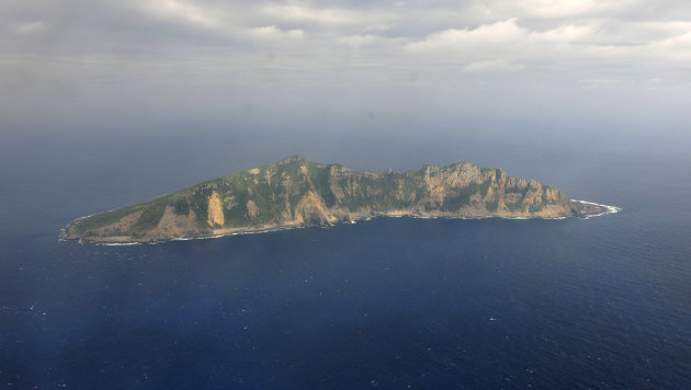 <p>               FILE - In this Dec. 13, 2012 file photo released by China's Xinhua News Agency, one of the small islands in the East China Sea known as Senkaku in Japanese and Diaoyu in Chinese is seen from a Chinese marine surveillance plane.  China plans eventually to land a survey team on the uninhabited islands at the heart of an increasingly dangerous territorial dispute with Japan, a Chinese official said Tuesday, March 12, 2013, in the latest verbal salvo intended to bolster Beijing's territorial claims. (AP Photo/Xinhua, File) NO SALES