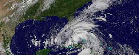 Tropical Storm Isaac is seen in this August 26, 2012 NASA handout satellite image as it approaches the Florida Keys. (Reuters)