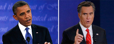 President Obama and Mitt Romney spar at the presidential debate (Reuters)