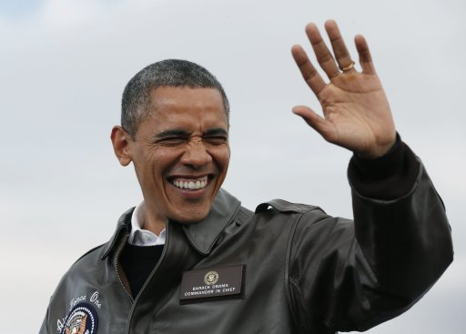 U.S. President Barack Obama waves at a campaign event at Austin Straubel Airport International Airport in Wisconsin