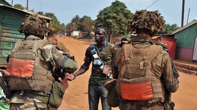 French troops speak to a member of the Anti-Balaka Christian militia who handed over his arms in Bangui on January 25, 2014