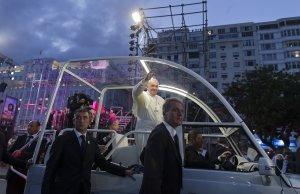 Pope Francis waves from his popemobile as he arrives…