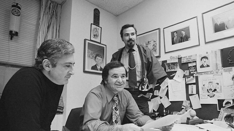 "FILE - In this 1972 file photo, ""Mad"" magazine Editor Al Feldstein, center, sits with Art Director John Putnam, left, and a freelancer named Jack, at the magazine's New York headquarters. Feldstein, whose 28 years at the helm of Mad transformed the satirical magazine into a pop culture institution, died Tuesday, April 29, 2014. He was 88. (AP Photo/Jerry Mosey, File)"