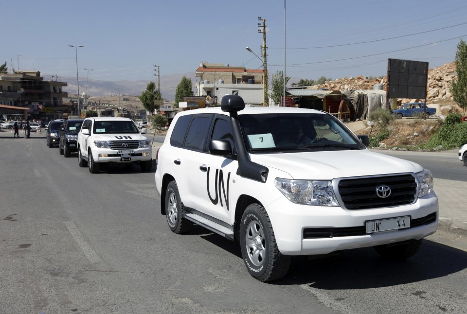 A convoy of inspectors from the Organization for the Prohibition of Chemical Weapons prepares to cross into Syria at the Lebanese border crossing point of Masnaa, eastern Bekaa Valley, Lebanon, Tuesday, Oct. 1, 2013. An advance group of 20 inspectors from a Netherlands-based chemical weapons watchdog arrived in Syria on Tuesday to begin their complex mission of finding, dismantling and ultimately destroying an estimated 1,000-ton chemical arsenal. (AP Photo/Bilal Hussein)