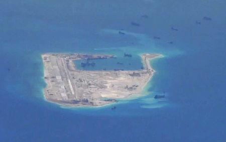 Still image from a United States Navy video purportedly shows Chinese dredging vessels in the waters around Fiery Cross Reef in the disputed Spratly...