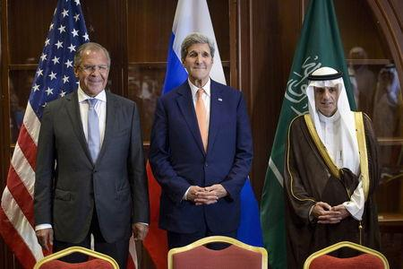 Russia's Foreign Minister Sergey Lavrov, U.S. Secretary of State John Kerry and Saudi Arabia's Foreign Minister Adel al-Jubeir stand together ...