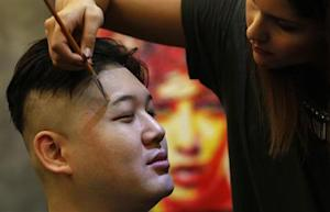 Howard gets make-up applied before turning into a Kim…