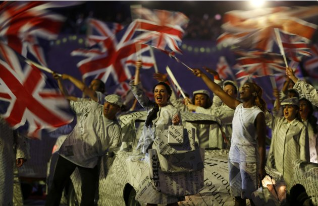 British flags are waved as the national anthem is sung during the closing ceremony of the London 2012 Olympic Games at the Olympic Stadium