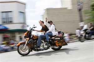 Harley riders wave during the Harley Davidson 110th …
