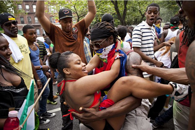 People dance on the streets during the annual West Indian Day parade in Brooklyn