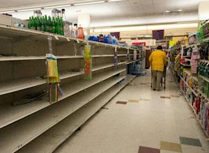 Frantic shoppers emptied grocery store shelves in preparation…