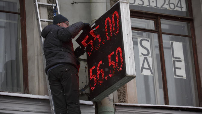 Russian ruble drops 7 percent as economy shrinks