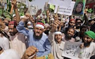 Pakistani supporters of Ahle Sunnat Wal Jamaat shout slogans during a rally to protest against a film insulting the Prophet Muhammad, in Karachi, Pakistan, Saturday, Sept. 29, 2012. (AP Photo/Fareed Khan)