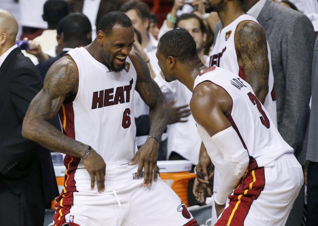 Miami Heat's James and Wade celebrate near the end of Game 5 of the NBA basketball finals against the Oklahoma City Thunder in Miami