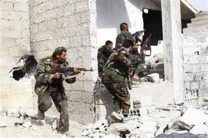 Shi'ite fighters, who support Syrian President Bashar al-Assad, search for rebels from house to house in the countryside near Damascus
