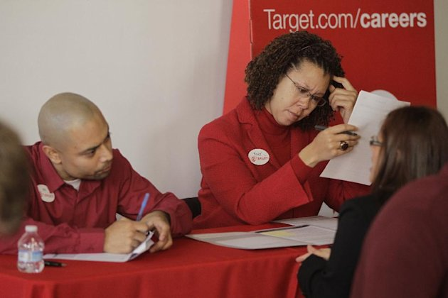 In this Thursday, Jan. 10, 2013, photo, Target human resources executives Will Castro, left, and Rachel Ferguson, middle, screen hundreds of prospective candidates awaiting their turn to apply for job openings at a Target job fair in Los Angeles. The number of Americans seeking unemployment aid fell to a five-year low last week, a hopeful sign the job market is healing. But much of the decline reflects seasonal volatility in the data. (AP Photo/Damian Dovarganes)