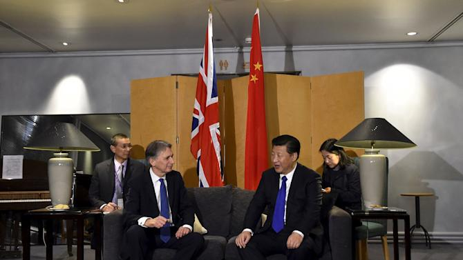 Airport, London, Monday, Oct. 19, 2015. Chinese President Xi Jinping ...