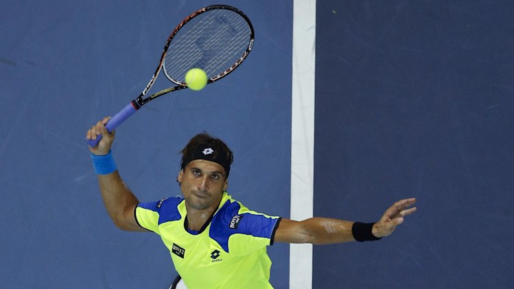 David Ferrer of Spain serves the ball against Joao Sousa of Portugal during their match at the Malaysian Open tennis tournament in Kuala Lumpur, Malaysia, Thursday, Sept 26, 2013