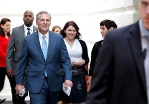 McCarthy arrives with staff members for a Republican caucus candidates' forum for the next House speaker, at the U.S. Capitol in Washington