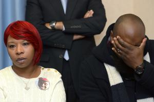 Lesley McSpadden, left, and Michael Brown, Sr., right,…