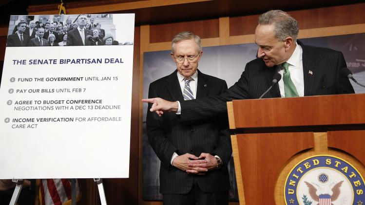 Schumer and Reid appear at a news conference in Washington