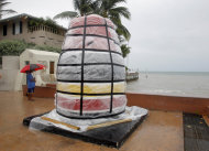 The southernmost point marker is covered in plastic sheeting in Key West, Fla., Saturday, Aug. 25, 2012, in preparation for Tropical Storm Isaac, Saturday, Aug. 25, 2012. Isaac's winds are expected to be felt in the Florida Keys by sunrise Sunday morning. (AP Photo/Alan Diaz)