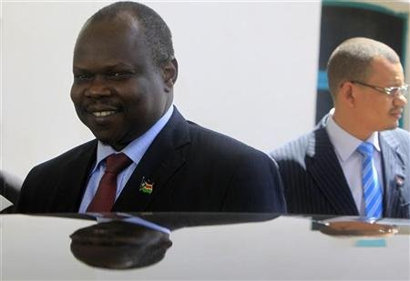 South Sudan's ruling SPLM party secretary general and head of the South Sudan delegation Amum smiles after a meeting Sudan's President Bashir in Khartoum