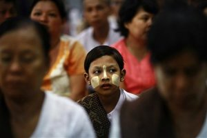 A girl sits among people attending the introduction …