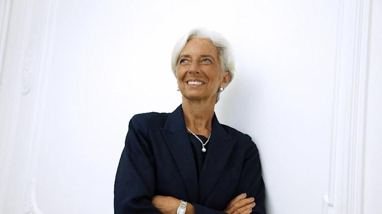 "IMF chief Christine Lagarde poses on the sideline of a press conference, on August 27, 2014 at her lawyer's office in Paris, after announcing she had been charged for ""negligence"" over a multi-million-euro corruption case"