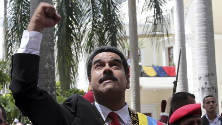 Venezuela's President Nicolas Maduro greets supporters as he arrives for a national assembly in Caracas