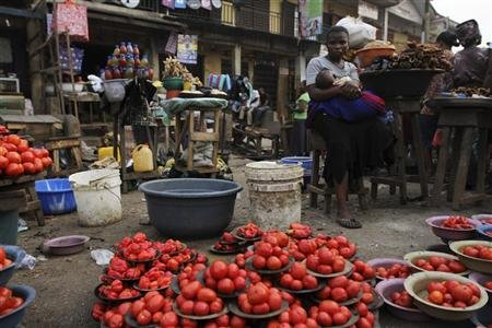 A woman waits for customer at a local food market in Nigeria's commercial capital Lagos, January 16, 2012. REUTERS/Akintunde Akinleye