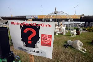 A sign bearing the name of one of the Chibok schoolgirls …