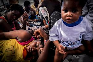 Refugees rest onboard the Dignity 1 search and rescue…