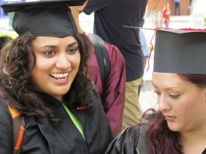 Wearing graduation-style caps and gowns, U.S.-raised …
