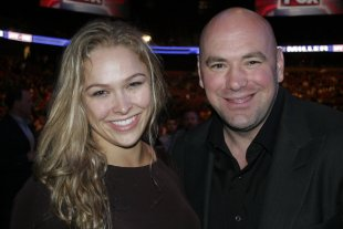 Dana White and Ronda Rousey pose during a UFC event. (Getty)