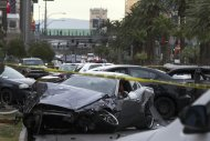 Wrecked cars are seen on Las Vegas Boulevard and Flamingo Avenue as Las Vegas Metro Police investigate a shooting and multi-car accident that left three people dead and at least three injured on the Las Vegas Strip in Las Vegas, Nevada in the early morning February 21, 2013. REUTERS/Las Vegas Sun/Steve Marcus (UNITED STATES - Tags: CRIME LAW)