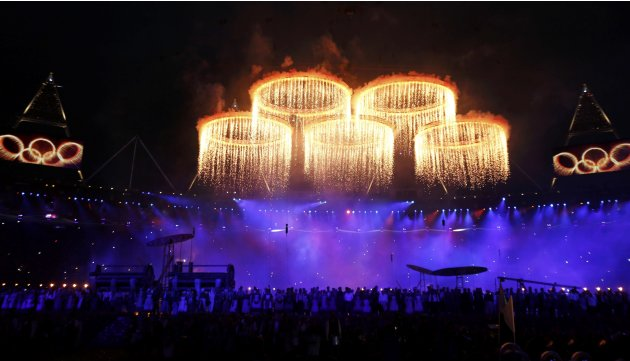 The Olympic rings are seen during a pyrotechnics display at the pre-show before the opening ceremony of the London 2012 Olympic Games at the Olympic Stadium