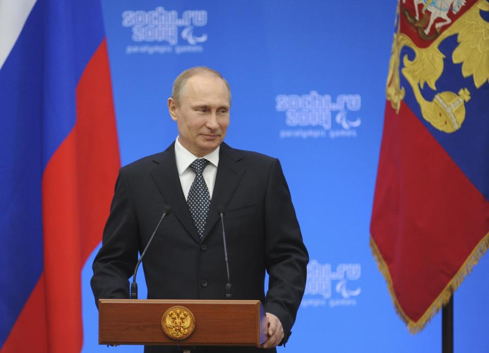Russian President Putin attends a ceremony to present state awards to paralympic atheletes in Sochi