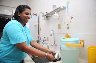 P. Krishna Vani stores water for washing in the kitchen and bathroom.