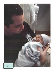 FILE - This undated file photo of former New York City police Officer Gilbert Valle with his baby daughter, was submitted into evidence by the defense in the trial of Valle, who was convicted in March in a bizarre plot to kidnap, cook and cannibalize women. Prosecutors alleged that Valle abused the FBI-operated National Crime Information Center database to to help compile dossiers on women he could possibly kidnap. It is not the first time a crooked officer has misused the database for cyber snooping and other offenses. (AP Photo/Provided by Attorney Julia L. Gatto, File)
